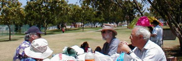 Members enjoy the park at the OASIS Summer Picnic Potluck.