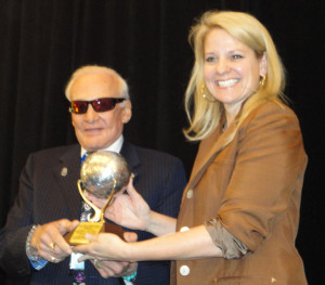 Buzz Aldrin presents the Space Pioneer Award for Entrepreneurial Business to Gwynne Shotwell