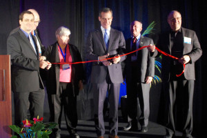 Los Angeles Mayor Eric Garcetti (center) cuts the ribbon opening ISDC 2014 as (from left) co-chair Nicola Sarzi-Amade, MC Ivan Rosenberg, chair Pat Montoure, keynote speaker David Gorney, and co-chair John Spencer look on. (Photo: Michael McGuire)