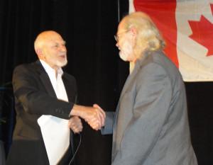 Professor Don Flournoy (left) congratulates second-prize winner Royce Jones. (Photo: Seth Potter)