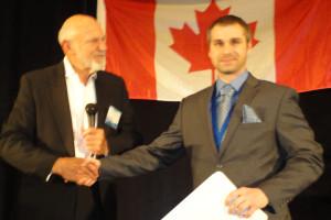 Professor Don Flournoy (left) congratulates second-prize winner Cory Bergsrud. (Photo: Seth Potter)