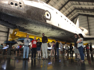 Even tall Ivor Dawson (center of photograph) is dwarfed by the Endeavour! Going left from Ivor - Lisa Kaspin-Powell, Gareth Powell and Seth Potter. The visit took place after the OASIS Summer Picnic, July 2014.